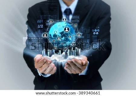 Businessman showing a virtual display of internet business network on his hand - stock photo