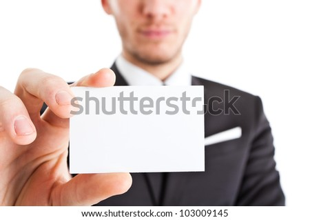 Businessman showing an empty business card - stock photo