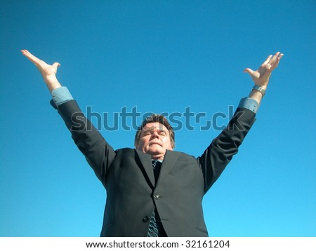 Businessman showing arms up potential - stock photo