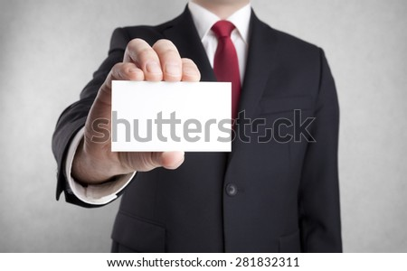 Businessman showing blank business card. Clipping path included. - stock photo