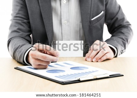 Businessman showing blank business card on table