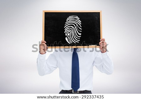 Businessman showing board against grey background - stock photo