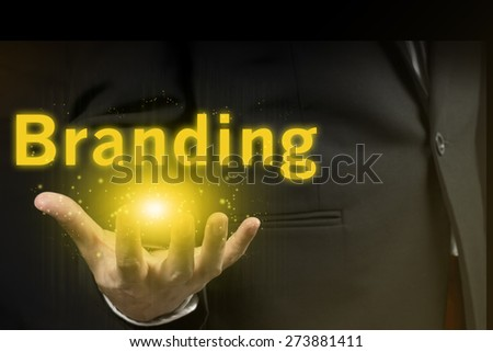 businessman showing branding word.marketing concept. - stock photo