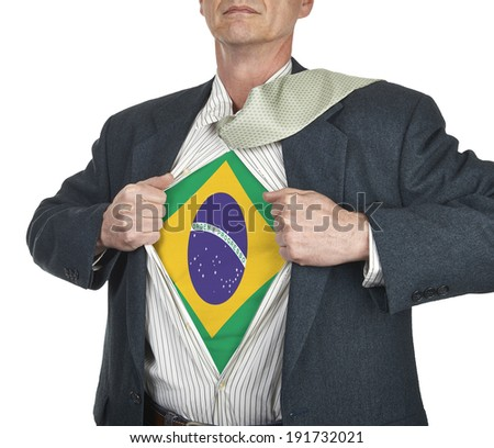 Businessman showing brazil flag superhero suit underneath his shirt standing against white background - stock photo