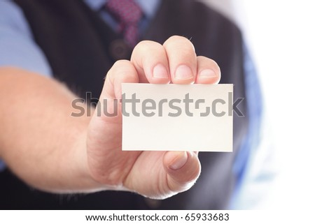 Businessman showing business card - focus on fingers and card. You can just add your text there. - stock photo
