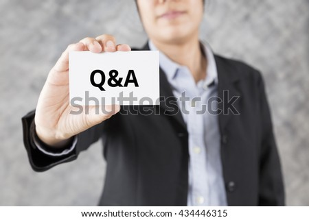 businessman showing business card with word Q&A