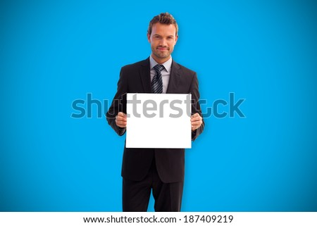 Businessman showing card against blue background with vignette - stock photo