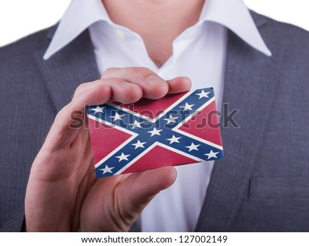 Businessman showing card, matte paper effect, Battle flag of the US Confederacy - stock photo