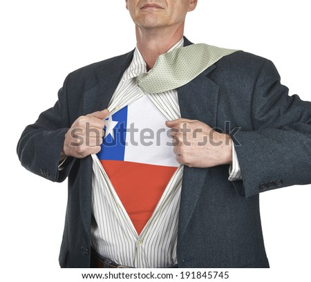 Businessman showing Chile flag superhero suit underneath his shirt standing against white background - stock photo