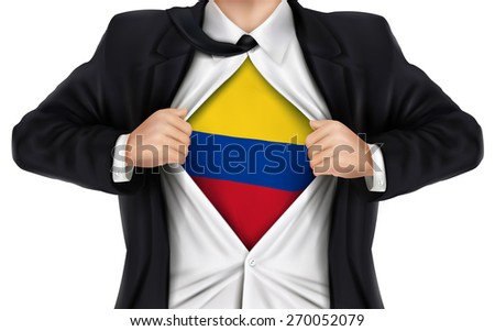 businessman showing Colombia flag underneath his shirt over white background - stock photo