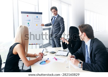 businessman showing data on whiteboard - stock photo