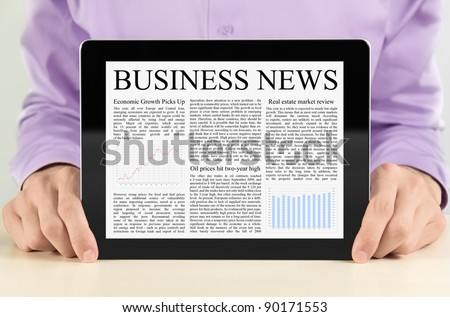 Businessman showing digital tablet pc with business news on screen. - stock photo