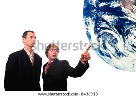businessman showing earth - stock photo