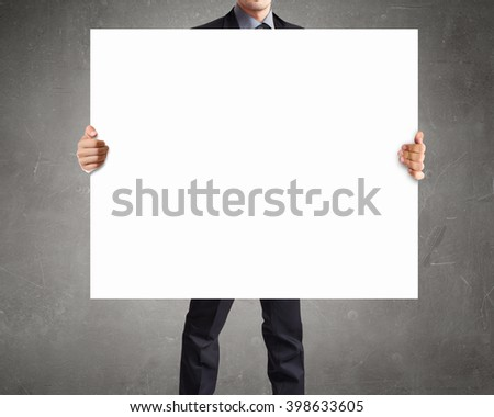 Businessman showing empty banner