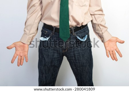 Businessman showing empty pockets concept for bankruptcy, poverty or penniless - stock photo
