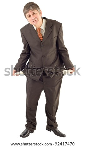 Businessman showing empty pockets isolated on white background - stock photo