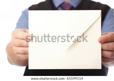 Businessman showing envelop. You can just add your text there. - stock photo