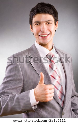 Businessman showing everything is OK - stock photo