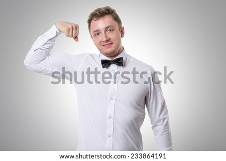 Businessman showing his bicep