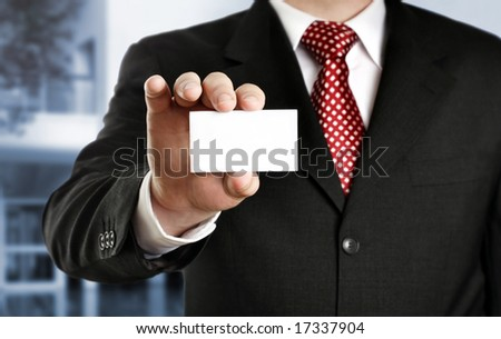 Businessman showing his business card, focus on fingers and card. - stock photo
