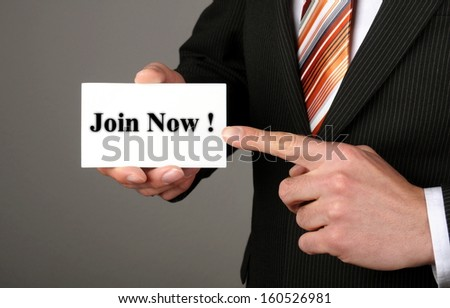 businessman showing his business card with the message join now - stock photo