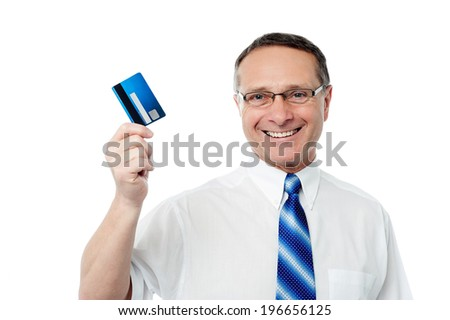 Businessman showing his credit card to camera