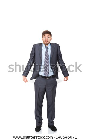 businessman showing his empty pocket, turning his pocket inside out, concept no money, Handsome young business man standing full length portrait isolated on the white background