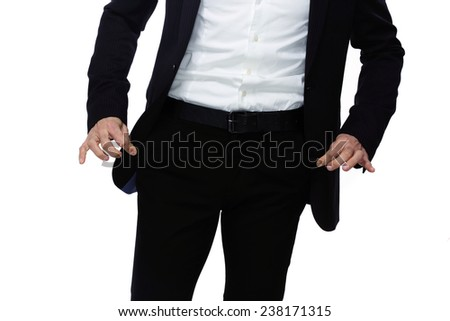 Businessman showing his empty pockets - stock photo