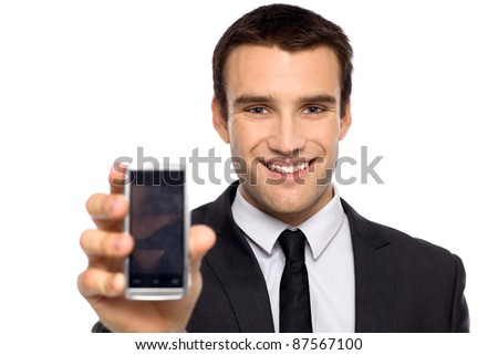 Businessman showing his mobile phone