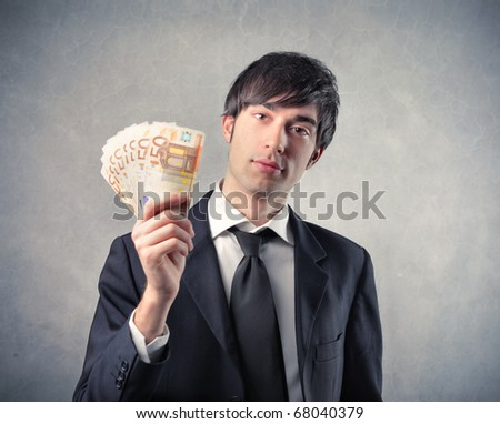 businessman showing his money - stock photo