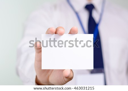 Businessman showing his name card.