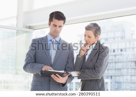 Businessman showing his notes to his colleague in the office