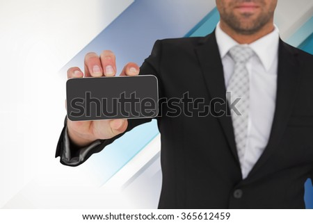 Businessman showing his smartphone screen against blue and white tile design