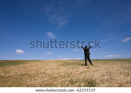 businessman showing his success at the field