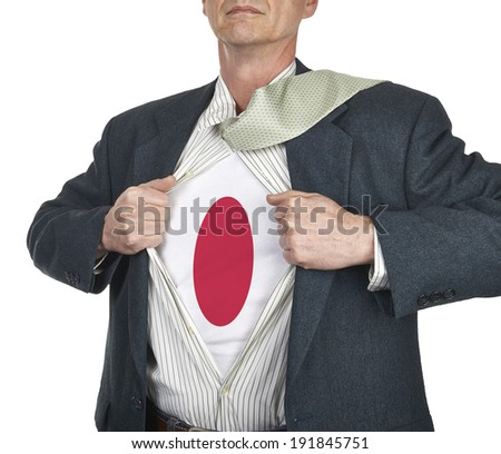 Businessman showing Japan flag superhero suit underneath his shirt standing against white background - stock photo