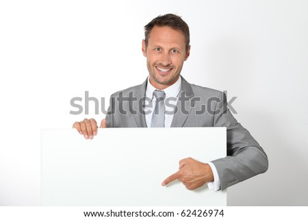 Businessman showing message board