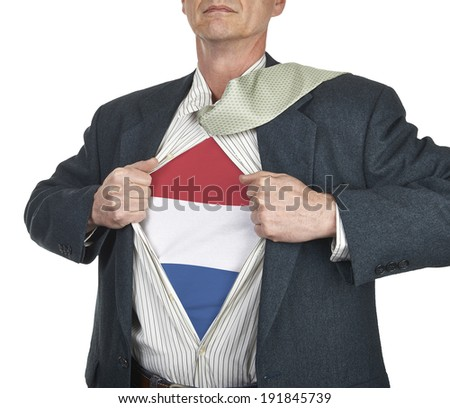 Businessman showing Netherlands flag superhero suit underneath his shirt standing against white background - stock photo