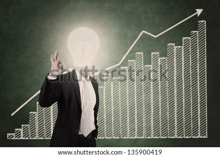 Businessman showing OK sign with head made of dollar sign - stock photo