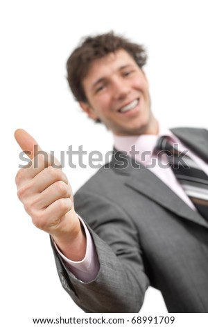 Businessman showing OK sign with his thumb up. Selective focus on hand, isolated.? - stock photo