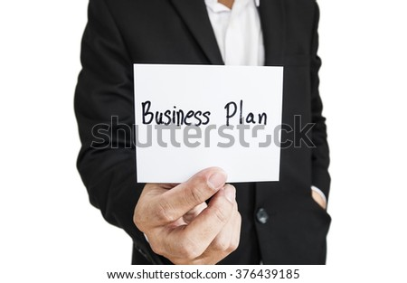 "Businessman showing paper note with the word ""Business Plan"", isolated on white background"