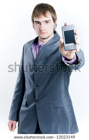 Businessman showing phone, focus on phone, isolated on white background - stock photo