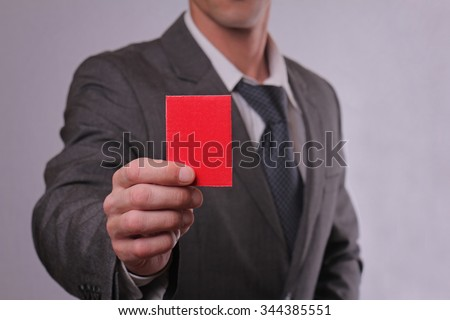 Businessman showing red card. Business and finance concept - stock photo