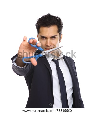 Businessman showing scissors in his right hand