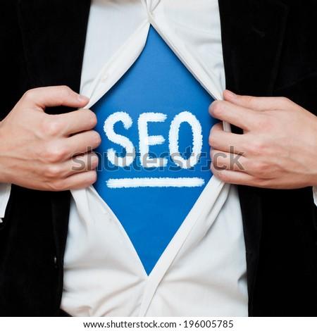 Businessman showing SEO word - stock photo