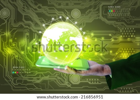 Businessman showing smart phone with globe - stock photo