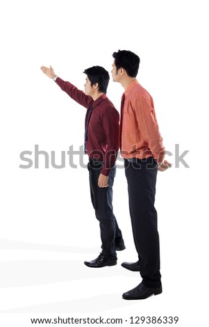 Businessman showing something to his manager/supervisor on white background - stock photo