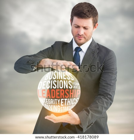 Businessman showing something with his hands against grey sky over ocean - stock photo