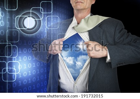 Businessman showing superhero suit underneath his shirt standing against black technology background - stock photo