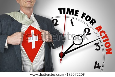 Businessman showing superhero suit with flag from Switzerland underneath his shirt standing against clock with time for action - path for the shirt - stock photo