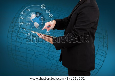 Businessman showing tablet with globe and icon application on virtual screen. Concept of online business. - stock photo